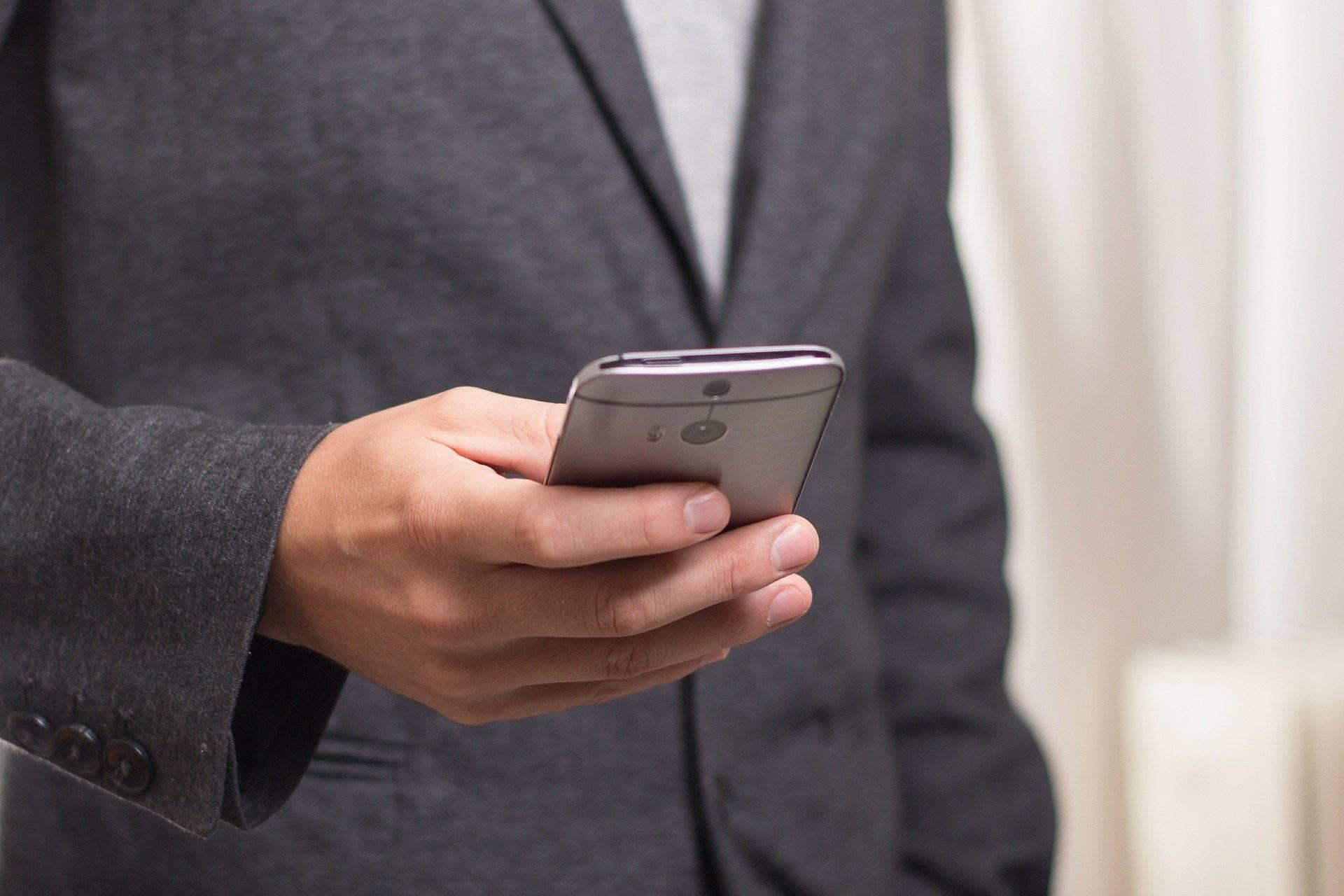 man using phone, latest travel news