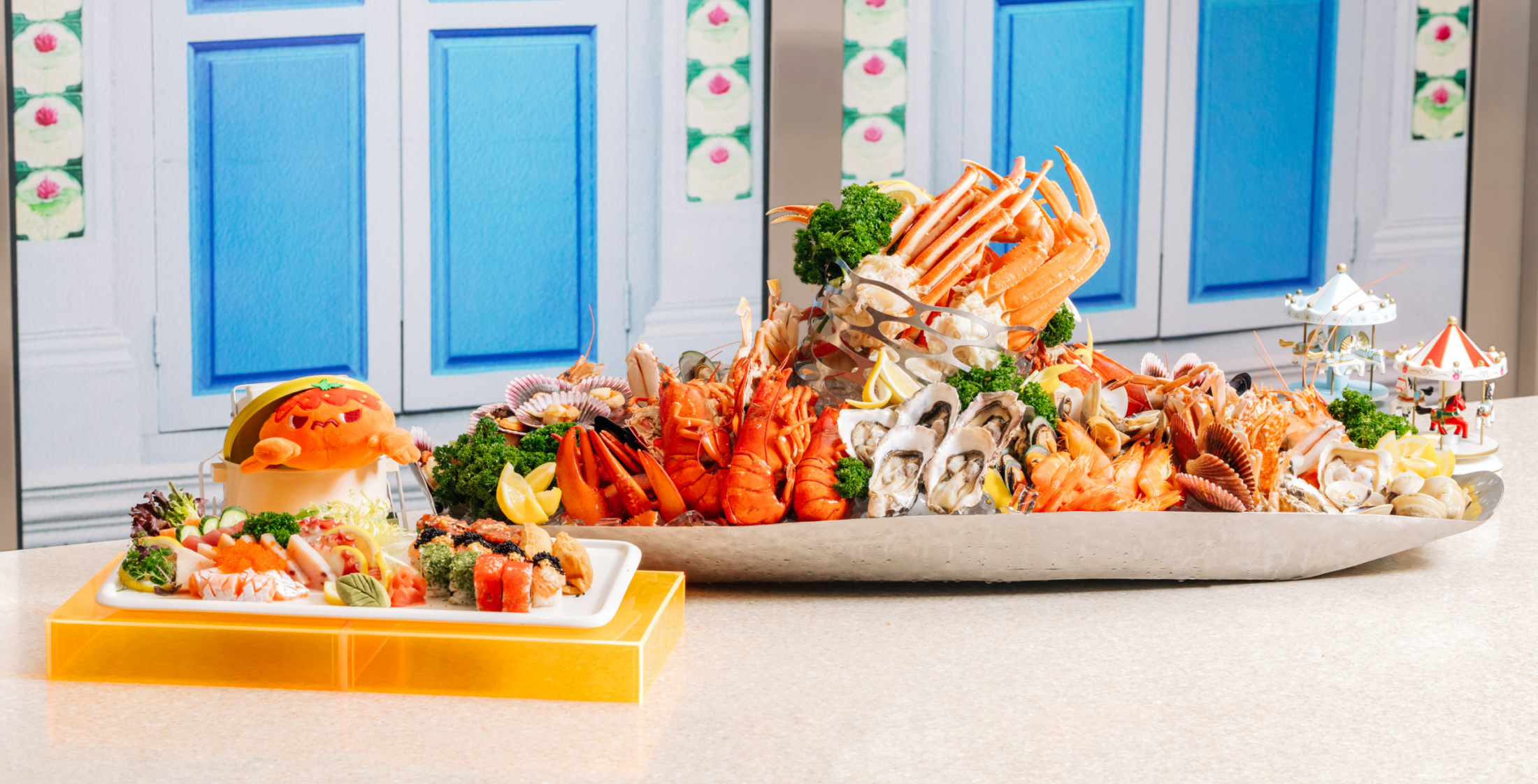 Platter of seafood - lobsters, prawns, oysters, crab, scallop, crayfish - and platter of sushi from Carousel Buffet Restaurant Singapore